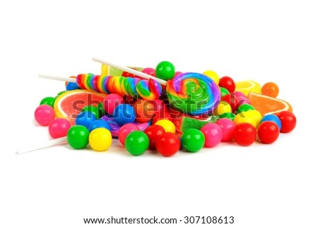 Pile of a variety of colorful candies against a white background - stock photo