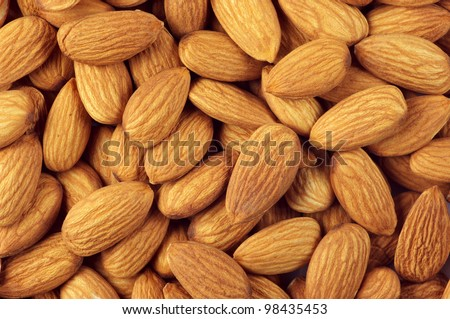 Pile of almonds close-up as background. - stock photo