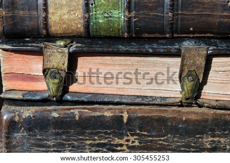Pile of antique books with clasps  - stock photo