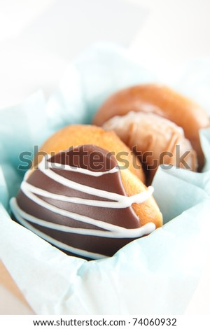 Pile of Assorted Doughnuts on White Background - stock photo