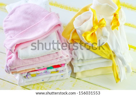Pile of baby clothes - stock photo