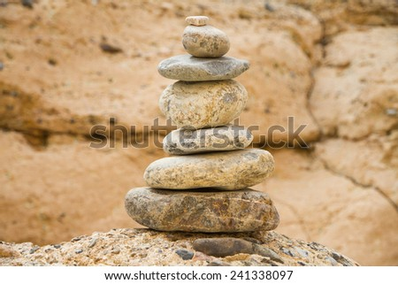 Pile of balanced stones in Sesriem Canyon, Namibia - stock photo