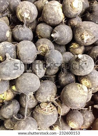 Pile of beetroot for sale at market - stock photo