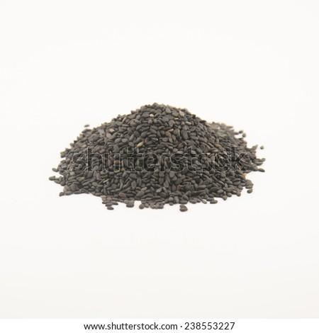 Pile of black sesame seeds isolated on white background - stock photo
