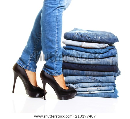 Pile of blue jeans isolated on white. - stock photo