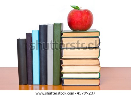Pile of books and apple - stock photo