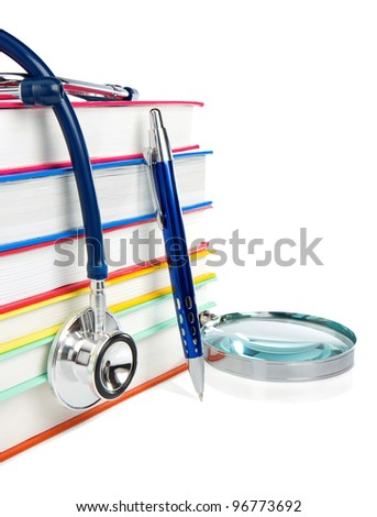 pile of books and medical stethoscope isolated on white background - stock photo