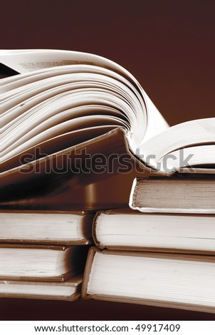 pile of books in sepia color - stock photo