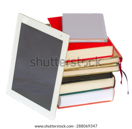 pile of books with modern tablet PC isolated on white - stock photo