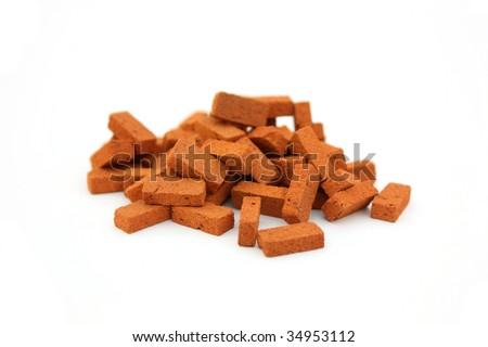 Pile of bricks isolated - stock photo