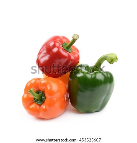 Pile of bright and colorful ripe peppers isolated over the white background - stock photo