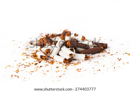 Pile of brown and white broken cigarettes isolated on a white background - stock photo