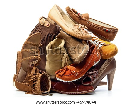 Pile of brown female shoes isolated on white background - stock photo