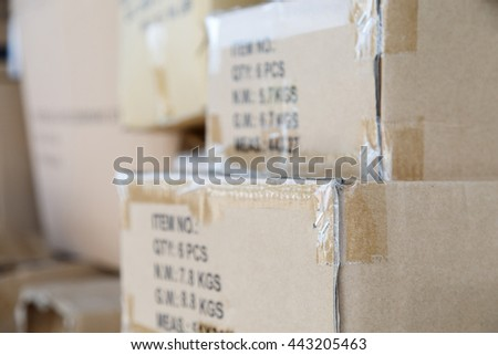 Pile of brown old used cardboard boxes at warehouse of market. Different stuff packed in set of carton boxes ready for delivery, ship insurance, logistics business, garbage utilization concept - stock photo