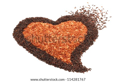 pile of brown rice in heart shape on white background - stock photo