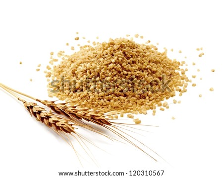 Pile of bulghur (couscous) with wheat ears on white background - stock photo