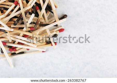 Pile of burnt and whole matches on light background - stock photo
