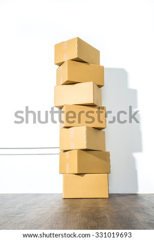 Pile of cardboard boxes on white background with box shadow, nobody - stock photo