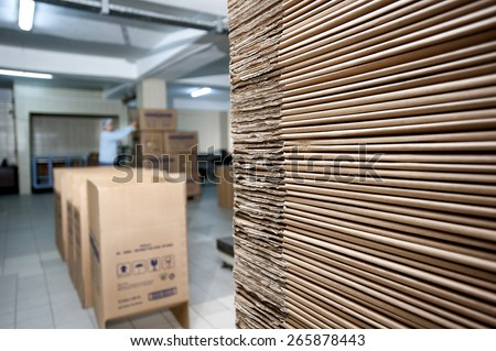 Pile of cardboard in a factory - stock photo