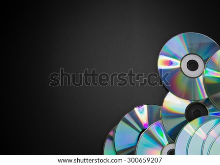 Pile of CDs on black background - stock photo