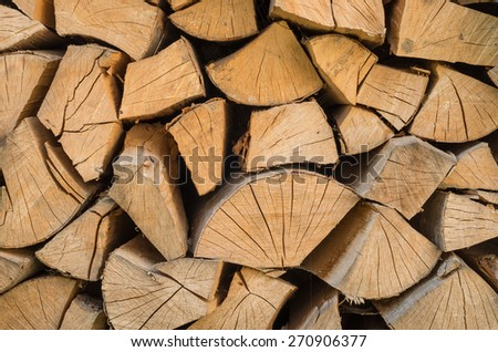 pile of chopped beech fire wood - stock photo