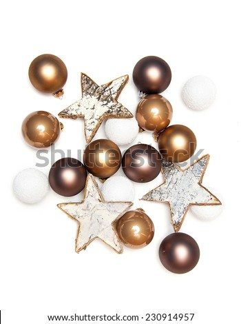 Pile of christmas holiday ornaments on a white background, glass balls and wooden stars - stock photo