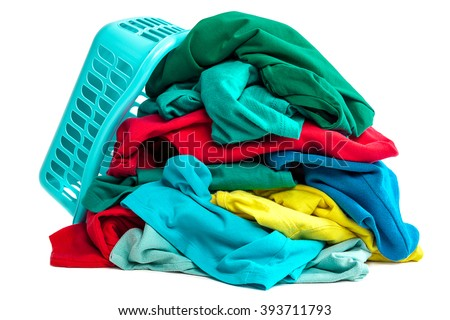 Pile of clothes to wash and a plastic container isolated on white background. - stock photo