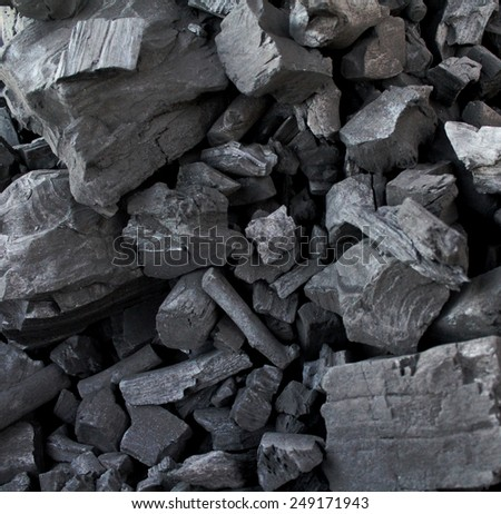 Pile of coal makes a cool pattern for a background. - stock photo
