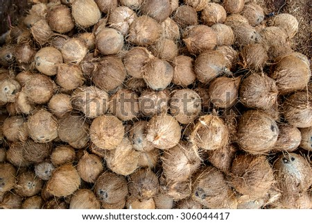 Pile of coconuts - good raw material for wellness solution - stock photo