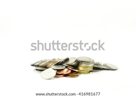 Pile of coins on a white background - stock photo