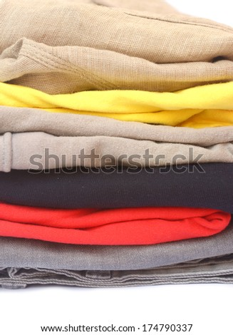 pile of color clothes on white background - stock photo