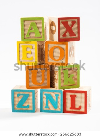 Pile of Colored Wooden Baby Alphabet Blocks in Close up Isolated on White Background - stock photo