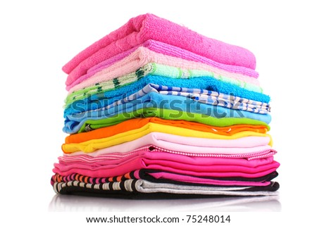Pile of colorful clothes over white background - stock photo