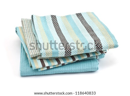 Pile of colorful kitchen towels isolated on white background - stock photo