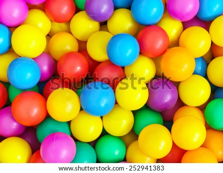 Pile of colorful little balls for children to play around - stock photo