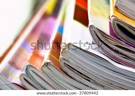Pile of colorful magazines close up - stock photo