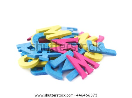 Pile of colorful painted wooden letters isolated over the white background - stock photo