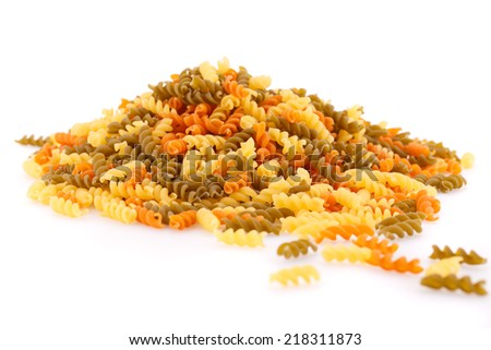 Pile of colorful pasta on white background. - stock photo