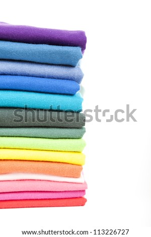 Pile of colorful t-shirts - stock photo