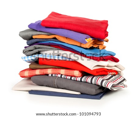 Pile of coloured clothes from the laundry - isolated on white - stock photo