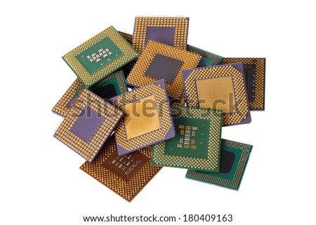 Pile of computer processor chips cut out on white background - stock photo