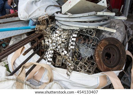 Pile of construction metals in factory after Tsunami. Steel tubes, kid's bike,  iron pipes - stock photo