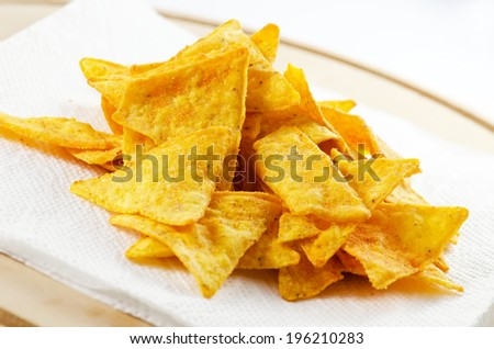 Pile of corn nachos served as apetizer. - stock photo