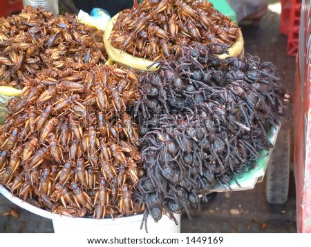 Pile of crickets and spiders for sale in cambodian market - stock photo