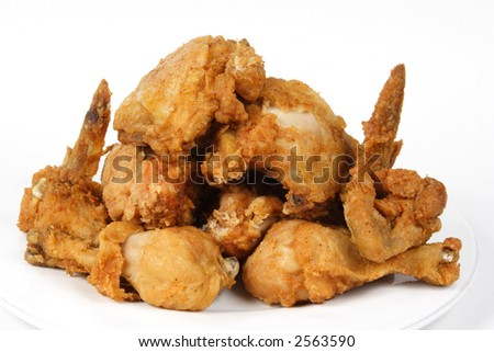 Pile of Crispy Golden brown fried chicken on a white background. - stock photo
