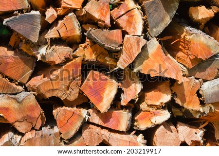 Pile of cut firewood logs background texture pattern - stock photo