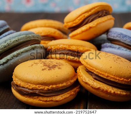 ... delicious blue and orange macaroons with ganache filling - stock photo