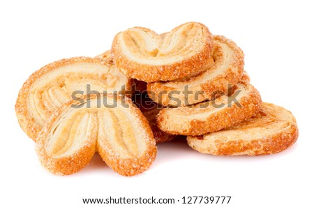 Pile of delicious cookies over white background - stock photo