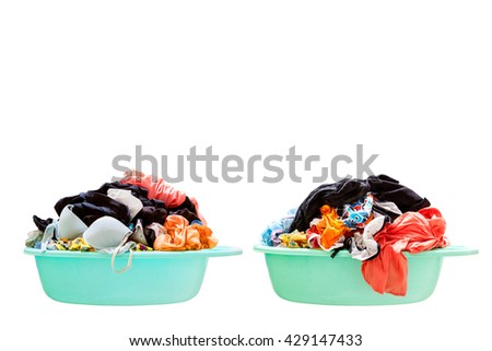 Pile of dirty laundry in a washing basket on white background - stock photo