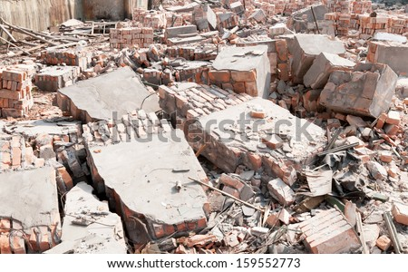 Pile of Discarded Bricks from Construction Site - stock photo